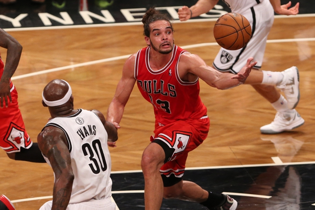 Apr 29, 2013; Brooklyn, NY, USA;  Chicago Bulls center Joakim Noah (13) grabs a loose ball during the third quarter against the Brooklyn Nets in game five of the first round of the 2013 NBA playoffs at the Barclays Center. Brooklyn won 110-91.  Mandatory Credit: Anthony Gruppuso-USA TODAY Sports