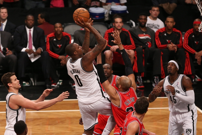 Apr 29, 2013; Brooklyn, NY, USA; Brooklyn Nets center Andray Blatche (0) shoots over Chicago Bulls defense during the fourth quarter in game five of the first round of the 2013 NBA playoffs at the Barclays Center. Brooklyn won 110-91.  Mandatory Credit: Anthony Gruppuso-USA TODAY Sports