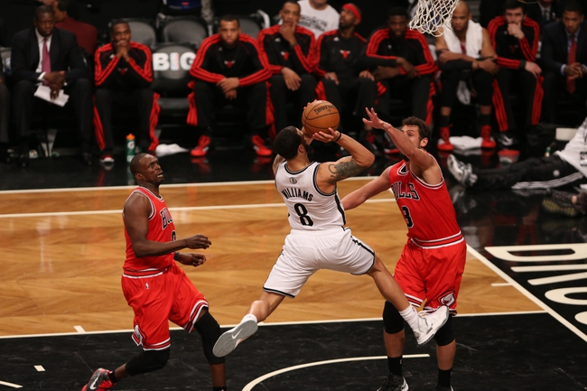 Apr 29, 2013; Brooklyn, NY, USA;Brooklyn Nets point guard Deron Williams (8) drives up to the net during the fourth quarter against the Chicago Bulls in game five of the first round of the 2013 NBA playoffs at the Barclays Center. Brooklyn won 110-91.  Mandatory Credit: Anthony Gruppuso-USA TODAY Sports