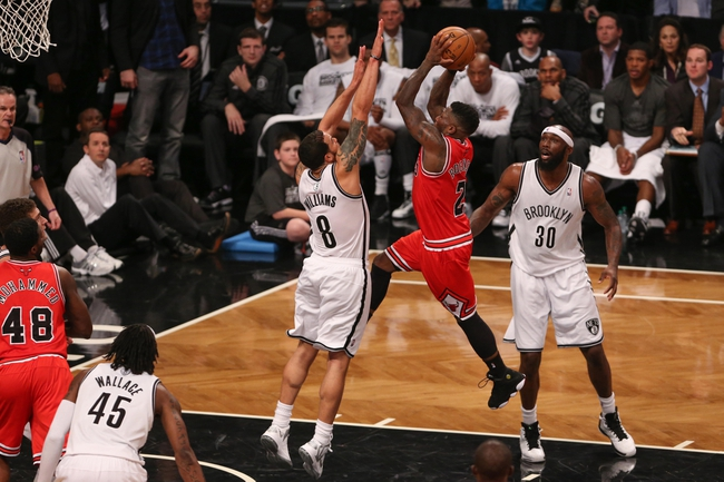 Apr 29, 2013; Brooklyn, NY, USA; Chicago Bulls point guard Nate Robinson (2) shoots over Brooklyn Nets point guard Deron Williams (8) during the third quarter in game five of the first round of the 2013 NBA playoffs at the Barclays Center. Brooklyn won 110-91.  Mandatory Credit: Anthony Gruppuso-USA TODAY Sports