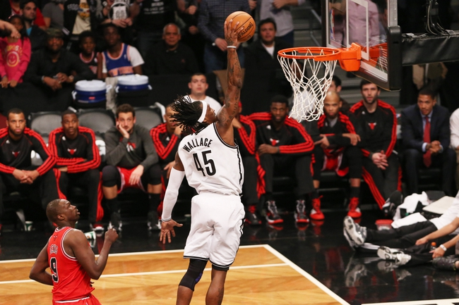 Apr 29, 2013; Brooklyn, NY, USA;  Brooklyn Nets small forward Gerald Wallace (45) dunks during the fourth quarter against the Chicago Bulls in game five of the first round of the 2013 NBA playoffs at the Barclays Center. Brooklyn won 110-91.  Mandatory Credit: Anthony Gruppuso-USA TODAY Sports