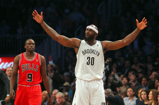 Apr 29, 2013; Brooklyn, NY, USA; Brooklyn Nets forward Reggie Evans (30) reacts in front of Chicago Bulls forward Luol Deng (9) during the third quarter of game five of the first round of the 2013 NBA playoffs at the Barclays Center. Mandatory Credit: Brad Penner-USA TODAY Sports