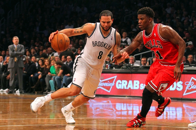 Apr 29, 2013; Brooklyn, NY, USA; Brooklyn Nets guard Deron Williams (8) controls the ball in front of Chicago Bulls forward Jimmy Butler (21) during the third quarter of game five of the first round of the 2013 NBA playoffs at the Barclays Center. Mandatory Credit: Brad Penner-USA TODAY Sports