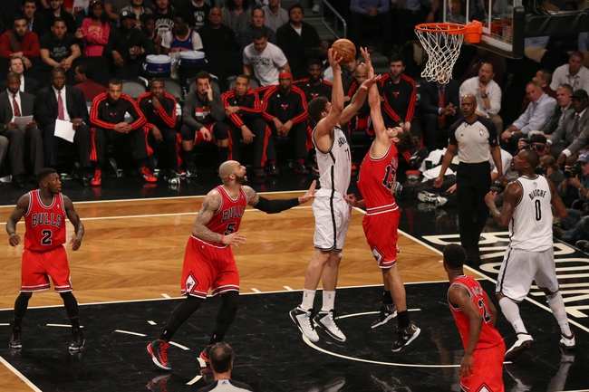 Apr 29, 2013; Brooklyn, NY, USA; Brooklyn Nets center Brook Lopez (11) shoots over Chicago Bulls center Joakim Noah (13) during the fourth quarter in game five of the first round of the 2013 NBA playoffs at the Barclays Center. Brooklyn won 110-91.  Mandatory Credit: Anthony Gruppuso-USA TODAY Sports
