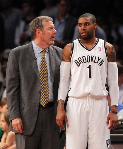 Apr 29, 2013; Brooklyn, NY, USA; Brooklyn Nets head coach P.J. Carlesimo talks with guard C.J. Watson (1) during the fourth quarter of game five of the first round of the 2013 NBA playoffs against the Chicago Bulls at the Barclays Center. Mandatory Credit: Brad Penner-USA TODAY Sports