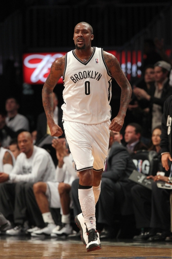 Apr 29, 2013; Brooklyn, NY, USA; Brooklyn Nets center Andray Blatche (0) reacts after a basket against the Chicago Bulls during the fourth quarter of game five of the first round of the 2013 NBA playoffs at the Barclays Center. Mandatory Credit: Brad Penner-USA TODAY Sports