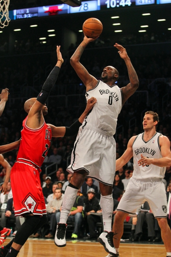 Apr 29, 2013; Brooklyn, NY, USA; Brooklyn Nets center Andray Blatche (0) shoots over Chicago Bulls forward Taj Gibson (22) during the fourth quarter of game five of the first round of the 2013 NBA playoffs at the Barclays Center. Mandatory Credit: Brad Penner-USA TODAY Sports