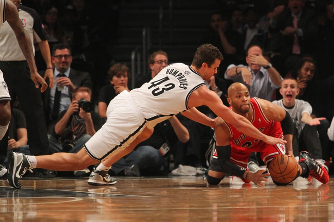 Apr 29, 2013; Brooklyn, NY, USA; Brooklyn Nets forward Kris Humphries (43) and Chicago Bulls forward Taj Gibson (22) dive for a loose ball during the fourth quarter of game five of the first round of the 2013 NBA playoffs at the Barclays Center. Mandatory Credit: Brad Penner-USA TODAY Sports