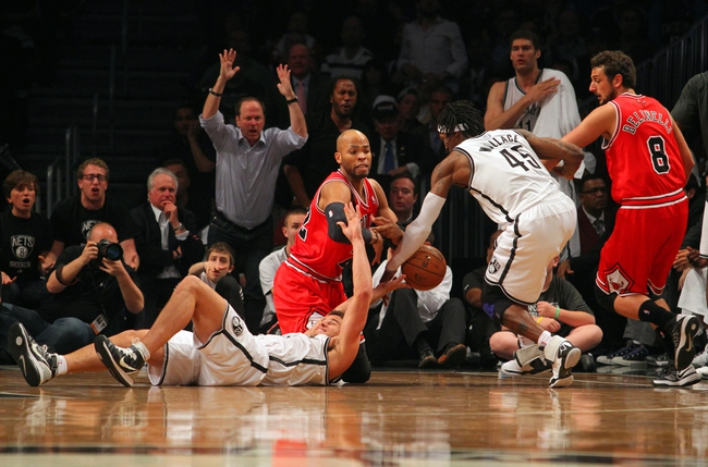 Apr 29, 2013; Brooklyn, NY, USA; Brooklyn Nets forward Kris Humphries (43) and Chicago Bulls forward Taj Gibson (22) and Nets forward Gerald Wallace (45) and Bulls guard Marco Belinelli (8) fight for a loose ball during the fourth quarter of game five of the first round of the 2013 NBA playoffs at the Barclays Center. Mandatory Credit: Brad Penner-USA TODAY Sports