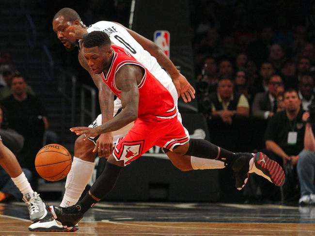 Apr 29, 2013; Brooklyn, NY, USA; Chicago Bulls guard Nate Robinson (2) is fouled by Brooklyn Nets center Andray Blatche (0) during the fourth quarter of game five of the first round of the 2013 NBA playoffs at the Barclays Center. Mandatory Credit: Brad Penner-USA TODAY Sports