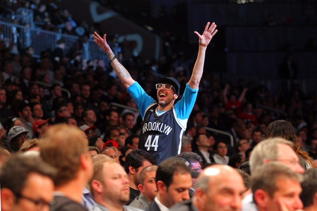 Apr 29, 2013; Brooklyn, NY, USA; A fan of the Brooklyn Nets celebrates during the fourth quarter of game five of the first round of the 2013 NBA playoffs against the Chicago Bulls at the Barclays Center. Mandatory Credit: Brad Penner-USA TODAY Sports