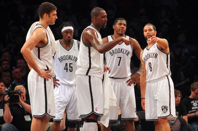 Apr 29, 2013; Brooklyn, NY, USA; Brooklyn Nets center Brook Lopez (11) and forward Gerald Wallace (45) and center Andray Blatche (0) and guard Joe Johnson (7) and guard Deron Williams (8) look on during a break in play during the fourth quarter of game five of the first round of the 2013 NBA playoffs against the Chicago Bulls at the Barclays Center. Mandatory Credit: Brad Penner-USA TODAY Sports