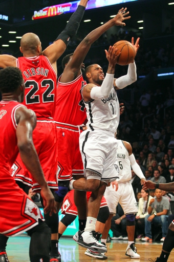 Apr 29, 2013; Brooklyn, NY, USA; Brooklyn Nets guard C.J. Watson (1) is fouled by Chicago Bulls center Nazr Mohammed (48) during the fourth quarter of game five of the first round of the 2013 NBA playoffs at the Barclays Center. Mandatory Credit: Brad Penner-USA TODAY Sports