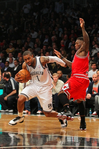 Apr 29, 2013; Brooklyn, NY, USA; Brooklyn Nets guard C.J. Watson (1) controls the ball in front of Chicago Bulls guard Nate Robinson (2) during the fourth quarter of game five of the first round of the 2013 NBA playoffs at the Barclays Center. Mandatory Credit: Brad Penner-USA TODAY Sports