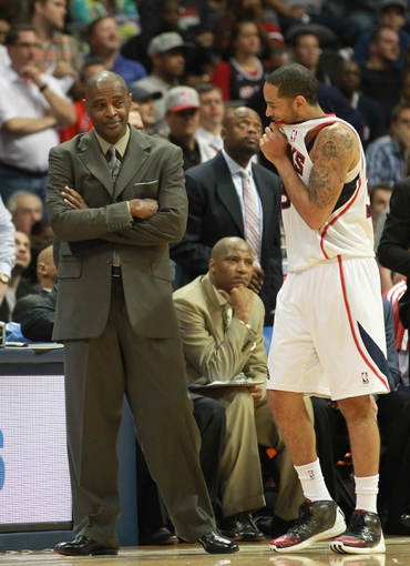 Apr 29, 2013; Atlanta, GA, USA; Atlanta Hawks guard Delvin Harris (34) talks to head coach Larry Drew during the closing moments of game four of the first round of the 2013 NBA playoffs at Philips Arena. Mandatory Credit: Marvin Gentry-USA TODAY Sports