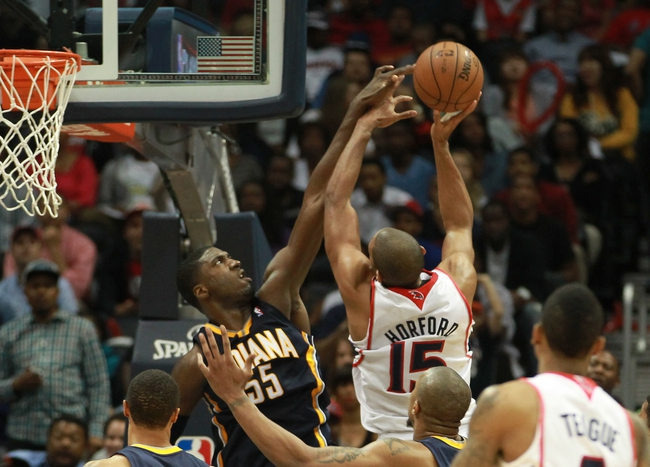 Apr 29, 2013; Atlanta, GA, USA; Indiana Pacers center Roy Hibbert (55) blocks the shot of Atlanta Hawks center Al Horford (15) in game four of the first round of the 2013 NBA playoffs at Philips Arena. Mandatory Credit: Marvin Gentry-USA TODAY Sports
