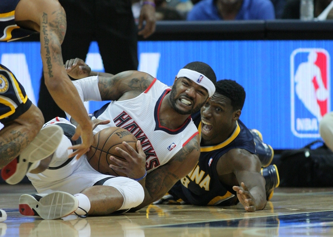 Apr 29, 2013; Atlanta, GA, USA; Atlanta Hawks forward Josh Smith (5) struggles to keep the ball away from Indiana Pacers center Ian Mahinmi (28)  in game four of the first round of the 2013 NBA playoffs at Philips Arena. Mandatory Credit: Marvin Gentry-USA TODAY Sports