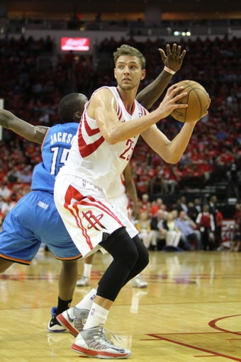 Apr 29, 2013; Houston, TX, USA; Houston Rockets small forward Chandler Parsons (25) passes the ball against the Oklahoma City Thunder in the second quarter in game four of the first round of the 2013 NBA playoffs at the Toyota Center. Mandatory Credit: Brett Davis-USA TODAY Sports