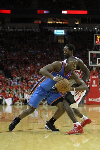 Apr 29, 2013; Houston, TX, USA; Oklahoma City Thunder point guard Reggie Jackson (15) is defended by Houston Rockets point guard Patrick Beverley (12) in the third quarter in game four of the first round of the 2013 NBA playoffs at the Toyota Center. The Rockets defeated the Thunder 105-103. Mandatory Credit: Brett Davis-USA TODAY Sports