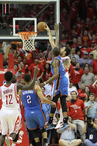 Apr 29, 2013; Houston, TX, USA; Houston Rockets shooting guard Carlos Delfino (10) dunks over Oklahoma City Thunder small forward Kevin Durant (35) in the third quarter in game four of the first round of the 2013 NBA playoffs at the Toyota Center. The Rockets defeated the Thunder 105-103. Mandatory Credit: Brett Davis-USA TODAY Sports