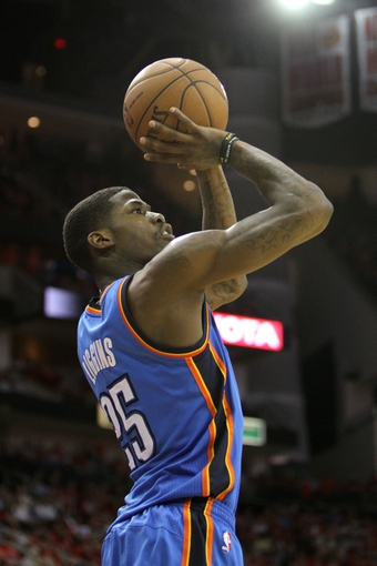 Apr 29, 2013; Houston, TX, USA; Oklahoma City Thunder shooting guard DeAndre Liggins (25) takes a shot against the Houston Rockets in the fourth quarter in game four of the first round of the 2013 NBA playoffs at the Toyota Center. The Rockets defeated the Thunder 105-103. Mandatory Credit: Brett Davis-USA TODAY Sports