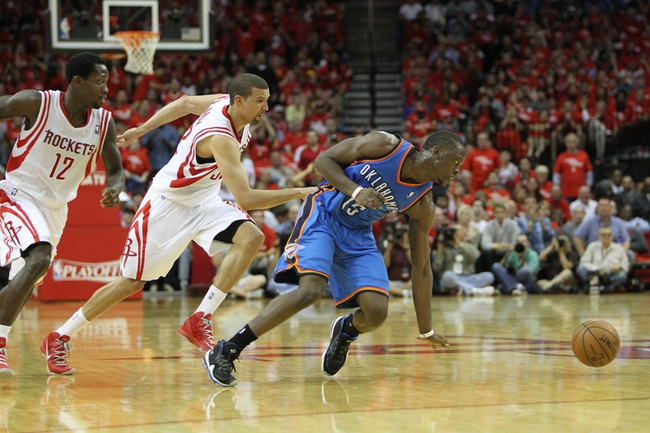 Apr 29, 2013; Houston, TX, USA; Oklahoma City Thunder point guard Reggie Jackson (15) and Houston Rockets shooting guard Francisco Garcia (32) and point guard Patrick Beverley (12) chase a loose ball in the fourth quarter in game four of the first round of the 2013 NBA playoffs at the Toyota Center. The Rockets defeated the Thunder 105-103. Mandatory Credit: Brett Davis-USA TODAY Sports