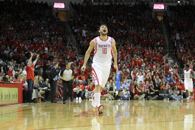 Apr 29, 2013; Houston, TX, USA; Houston Rockets shooting guard Carlos Delfino (10) shows emotion after a basket against the Oklahoma City Thunder in the fourth quarter in game four of the first round of the 2013 NBA playoffs at the Toyota Center. The Rockets defeated the Thunder 105-103. Mandatory Credit: Brett Davis-USA TODAY Sports