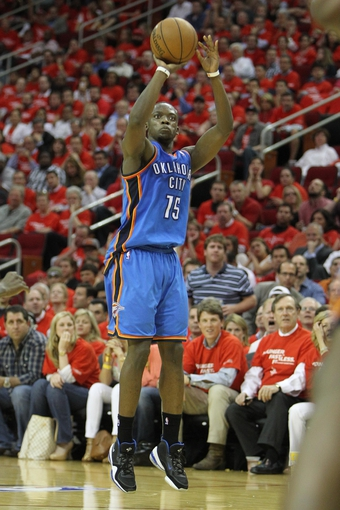 Apr 29, 2013; Houston, TX, USA; Oklahoma City Thunder shooting guard Reggie Jackson (15) takes a shot against the Houston Rockets in the fourth quarter in game four of the first round of the 2013 NBA playoffs at the Toyota Center. The Rockets defeated the Thunder 105-103. Mandatory Credit: Brett Davis-USA TODAY Sports