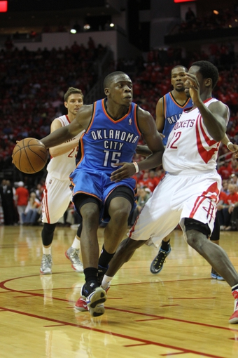 Apr 29, 2013; Houston, TX, USA; Oklahoma City Thunder point guard Reggie Jackson (15) is defended by Houston Rockets point guard Patrick Beverley (12) in the fourth quarter in game four of the first round of the 2013 NBA playoffs at the Toyota Center. The Rockets defeated the Thunder 105-103. Mandatory Credit: Brett Davis-USA TODAY Sports