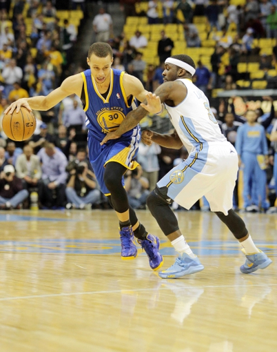 Apr 30, 2013; Denver, CO, USA; Denver Nuggets point guard Ty Lawson (3) guards Golden State Warriors point guard Stephen Curry (30) in the first quarter in game five of the first round of the 2013 NBA Playoffs at the Pepsi Center. Mandatory Credit: Isaiah J. Downing-USA TODAY Sports