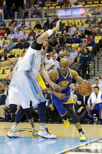Apr 30, 2013; Denver, CO, USA; Denver Nuggets center JaVale McGee (34) guards Golden State Warriors point guard Jarrett Jack (2) in the first quarter in game five of the first round of the 2013 NBA Playoffs at the Pepsi Center. Mandatory Credit: Isaiah J. Downing-USA TODAY Sports