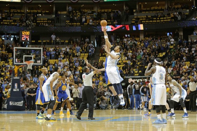 Apr 30, 2013; Denver, CO, USA; Golden State Warriors center Andrew Bogut (12) and Denver Nuggets center JaVale McGee (34) go up for the opening tip in the first quarter in game five of the first round of the 2013 NBA Playoffs at the Pepsi Center. Mandatory Credit: Isaiah J. Downing-USA TODAY Sports