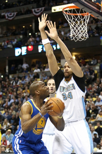Apr 30, 2013; Denver, CO, USA; Denver Nuggets center JaVale McGee (34) guards Golden State Warriors power forward Carl Landry (7) in the second quarter in game five of the first round of the 2013 NBA Playoffs at the Pepsi Center. Mandatory Credit: Isaiah J. Downing-USA TODAY Sports