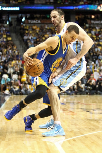 Apr 30, 2013; Denver, CO, USA; Denver Nuggets center Kosta Koufos (41) guards Golden State Warriors point guard Stephen Curry (30) in the second quarter in game five of the first round of the 2013 NBA Playoffs at the Pepsi Center. Mandatory Credit: Isaiah J. Downing-USA TODAY Sports