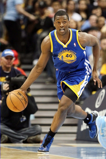 Apr 30, 2013; Denver, CO, USA; Golden State Warriors small forward Harrison Barnes (40) controls the ball in the second quarter against the Denver Nuggets in game five of the first round of the 2013 NBA Playoffs at the Pepsi Center. Mandatory Credit: Isaiah J. Downing-USA TODAY Sports