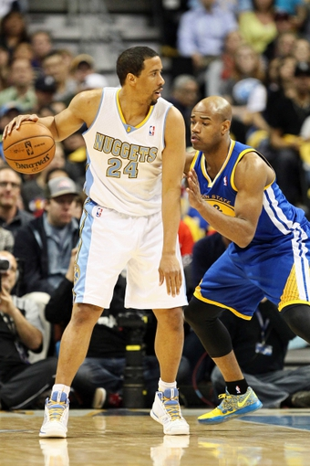 Apr 30, 2013; Denver, CO, USA; Golden State Warriors point guard Jarrett Jack (2) guards Denver Nuggets point guard Andre Miller (24) in the second quarter in game five of the first round of the 2013 NBA Playoffs at the Pepsi Center. Mandatory Credit: Isaiah J. Downing-USA TODAY Sports