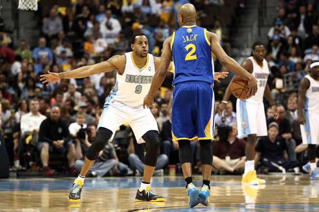 Apr 30, 2013; Denver, CO, USA; Denver Nuggets shooting guard Andre Iguodala (9) guards Golden State Warriors point guard Jarrett Jack (2) in the third quarter in game five of the first round of the 2013 NBA Playoffs at the Pepsi Center. The Nuggets won 107-100. Mandatory Credit: Isaiah J. Downing-USA TODAY Sports