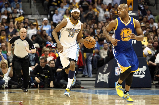 Apr 30, 2013; Denver, CO, USA; Denver Nuggets small forward Corey Brewer (13) keeps the ball from Golden State Warriors point guard Jarrett Jack (2) in the third quarter in game five of the first round of the 2013 NBA Playoffs at the Pepsi Center. The Nuggets won 107-100. Mandatory Credit: Isaiah J. Downing-USA TODAY Sports