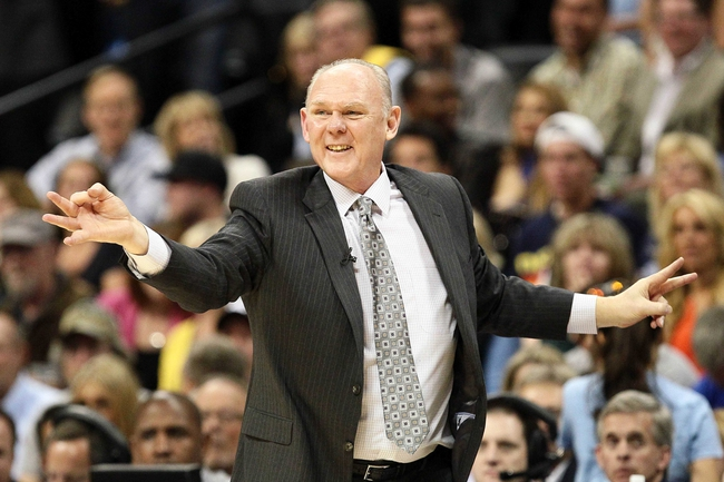 Apr 30, 2013; Denver, CO, USA; Denver Nuggets head coach George Karl reacts to a play in the third quarter against the Golden State Warriors in game five of the first round of the 2013 NBA Playoffs at the Pepsi Center. The Nuggets won 107-100. Mandatory Credit: Isaiah J. Downing-USA TODAY Sports