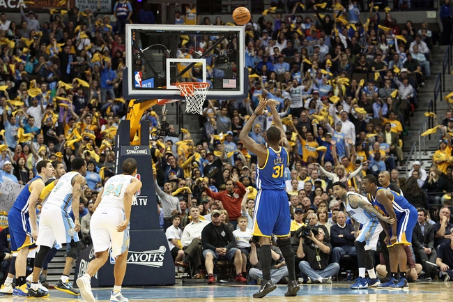 Apr 30, 2013; Denver, CO, USA; Golden State Warriors center Festus Ezeli (31) attempts a free throw in the fourth quarter against the Denver Nuggets in game five of the first round of the 2013 NBA Playoffs at the Pepsi Center. The Nuggets won 107-100. Mandatory Credit: Isaiah J. Downing-USA TODAY Sports