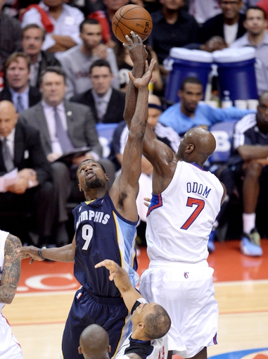 Apr 30, 2013; Los Angeles, CA, USA;  Los Angeles Clippers power forward Lamar Odom (7) taps out a jump ball against Memphis Grizzlies shooting guard Tony Allen (9) in the first half of game five of the first round of the 2013 NBA Playoffs at the Staples Center. Mandatory Credit: Jayne Kamin-Oncea-USA TODAY Sports