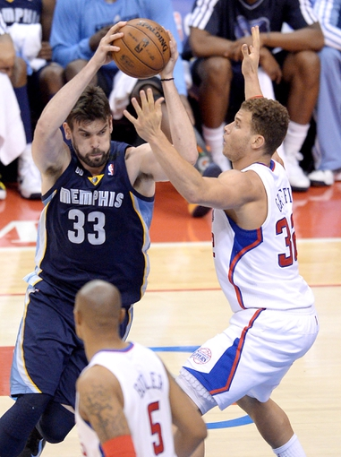 Apr 30, 2013; Los Angeles, CA, USA;  Los Angeles Clippers power forward Blake Griffin (32) guards Memphis Grizzlies center Marc Gasol (33) in the first half of game five of the first round of the 2013 NBA Playoffs at the Staples Center. Mandatory Credit: Jayne Kamin-Oncea-USA TODAY Sports