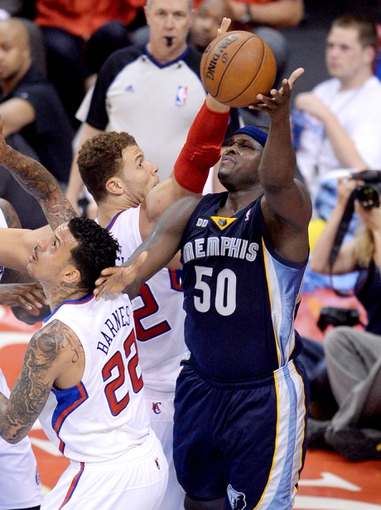 Apr 30, 2013; Los Angeles, CA, USA;  Los Angeles Clippers power forward Blake Griffin (32) blocks a shot by Memphis Grizzlies power forward Zach Randolph (50) in the first half of game five of the first round of the 2013 NBA Playoffs at the Staples Center. Mandatory Credit: Jayne Kamin-Oncea-USA TODAY Sports