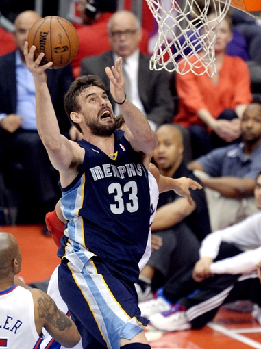 Apr 30, 2013; Los Angeles, CA, USA;  Memphis Grizzlies center Marc Gasol (33) makes a shot in front of Los Angeles Clippers power forward Blake Griffin (32) in the first half of game five of the first round of the 2013 NBA Playoffs at the Staples Center. Mandatory Credit: Jayne Kamin-Oncea-USA TODAY Sports