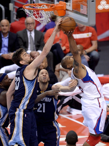 Apr 30, 2013; Los Angeles, CA, USA;  Memphis Grizzlies center Marc Gasol (33) blocks a shot by Los Angeles Clippers small forward Caron Butler (5) in the second half of game five of the first round of the 2013 NBA Playoffs at the Staples Center. Grizzlies won 103-93. Mandatory Credit: Jayne Kamin-Oncea-USA TODAY Sports