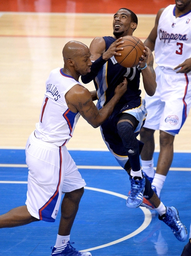 Apr 30, 2013; Los Angeles, CA, USA;  Los Angeles Clippers point guard Chauncey Billups (1) fouls Memphis Grizzlies point guard Mike Conley (11) in the second half of game five of the first round of the 2013 NBA Playoffs at the Staples Center. Grizzlies won 103-93. Mandatory Credit: Jayne Kamin-Oncea-USA TODAY Sports