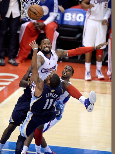 Apr 30, 2013; Los Angeles, CA, USA;  Los Angeles Clippers center Ronny Turiaf (21) blocks a shot by Memphis Grizzlies point guard Mike Conley (11) in the second half of game five of the first round of the 2013 NBA Playoffs at the Staples Center. Grizzlies won 103-93. Mandatory Credit: Jayne Kamin-Oncea-USA TODAY Sports