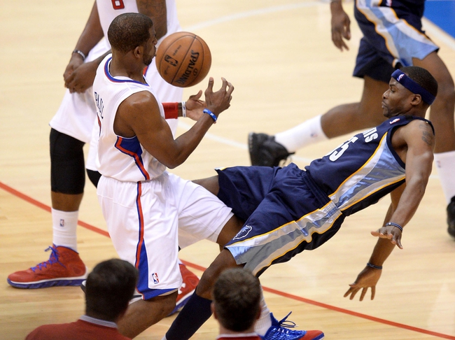 Apr 30, 2013; Los Angeles, CA, USA;  Memphis Grizzlies point guard Keyon Dooling (55) is charged with a foul on Los Angeles Clippers point guard Chris Paul (3) in the second half of game five of the first round of the 2013 NBA Playoffs at the Staples Center. Grizzlies won 103-93. Mandatory Credit: Jayne Kamin-Oncea-USA TODAY Sports