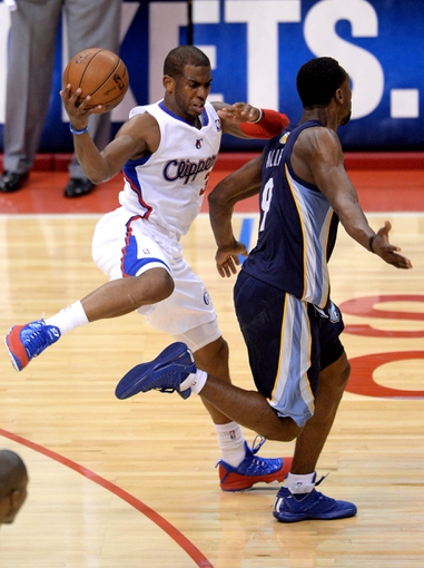 Apr 30, 2013; Los Angeles, CA, USA;  Los Angeles Clippers point guard Chris Paul (3) runs down court past Memphis Grizzlies shooting guard Tony Allen (9) in the second half of game five of the first round of the 2013 NBA Playoffs at the Staples Center. Grizzlies won 103-93. Mandatory Credit: Jayne Kamin-Oncea-USA TODAY Sports