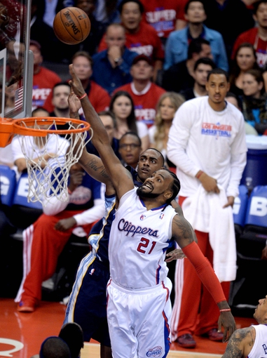Apr 30, 2013; Los Angeles, CA, USA;  Los Angeles Clippers center Ronny Turiaf (21) blocks a shot by Memphis Grizzlies power forward Darrell Arthur (00) in the second half of game five of the first round of the 2013 NBA Playoffs at the Staples Center. Grizzlies won 103-93. Mandatory Credit: Jayne Kamin-Oncea-USA TODAY Sports